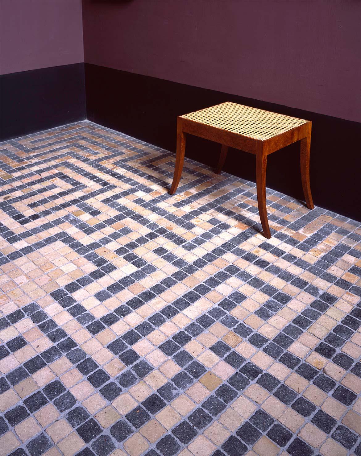 Floor mosaic in gallery bay 6 with stool by Carl Petersen and Kaare Klint.